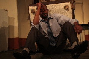 Joe Kinyua as Mel Photo by Friends Theatre Ensemble