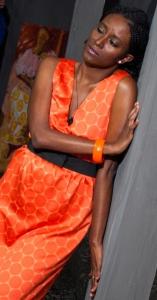 Hana Kefela as Lady in Orange